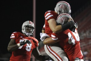 After a TD, UNLV offensive lineman Robert Waterman hugs tight end Jake Phillips in the end zone in the second quarter.
