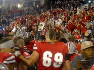 UNLV players sang the school's fight song with fans after their 27-22 victory at Nevada on Oct. 26, 2013.