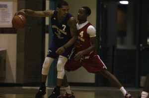 Former UNLV Rebel Anthony Marshall (Mojave) battles for post position against incoming UNLV senior Kevin Olekaibe during the second week of action at the Desert Reign ProCity League over the summer.