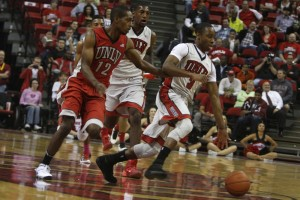 UNLV senior Kevin Olekaibe leads the break for the Gray team during the first half of the scrimmage.