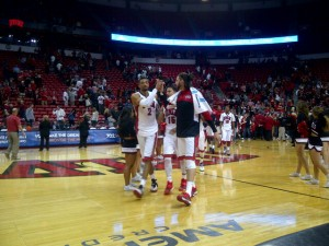 Khem Birch, left, and Carlos Lopez-Sosa glasp hands after UNLV's hard-fought 73-70 win over Omaha.