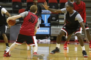 UNLV junior Roscoe Smith plays defense against freshman Dantley Walker at practice Thursday afternoon.