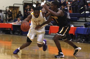 Durango senior guard Darryl Gaynor drives against a defender from Bishop O'Dowd during day 2 of the Tarkanian Classic.