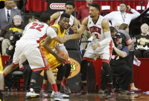 UNLV defenders surround Wyoming forward Derek Cooke Jr. in the first half of UNLV's MWC quarterfinal game against Wyoming.