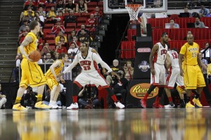 The Rebels play defense against the Cowboys in the first half of UNLV's MWC quarterfinal game against Wyoming.