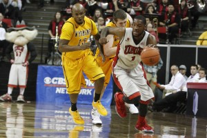 UNLV forward Roscoe Smith dribbles the ball in transition in the first half of UNLV's MWC quarterfinal game against Wyoming. He returned tonight after missing the final two regular season games with a concussion.