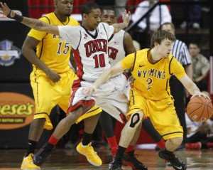 UNLV guard Daquan Cook defends Wyoming guard Riley Grabau in the first half of UNLV's MWC quarterfinal game against Wyoming.