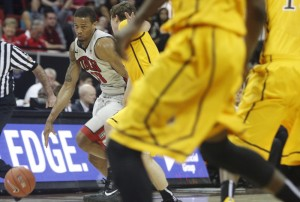 UNLV guard Bryce Dejean-Jones dribbles before hitting a jumper to beat the buzzer in the end of the first half of UNLV's MWC quarterfinal game against Wyoming.