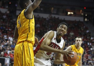 UNLV forward Chris Wood battles for post position against Wyoming forward Derek Cooke Jr. in the second half of UNLV's MWC quarterfinal game against Wyoming.