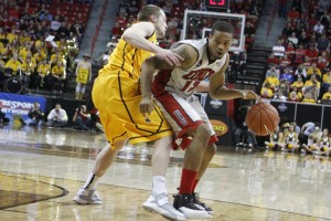 UNLV forward Bryce Dejean-Jones dribbles into the lane in the second half of UNLV's MWC quarterfinal game against Wyoming. He led the Rebels with 22 points.