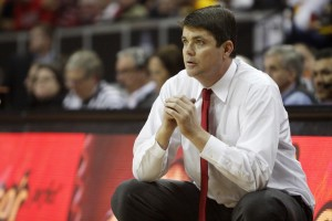 UNLV head coach Dave Rice watches from the bench in the second half of UNLV's MWC quarterfinal game against Wyoming.