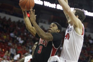 UNLV guard Kevin Olekaibe drives to the basket in the first half of UNLV's MWC semifinal game against San Diego St.