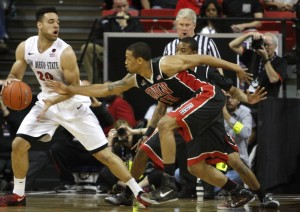 UNLV guard Bryce Dejean-Jones tries to steal the ball away from SDSU forward JJ O'Brien in the first half of UNLV's MWC semifinal game against San Diego St.