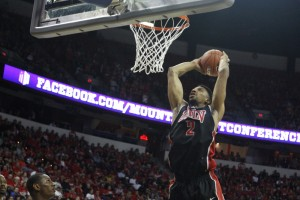 UNLV center Khem Birch jumps up for a slam dunk in the first half of UNLV's MWC semifinal game against San Diego St.