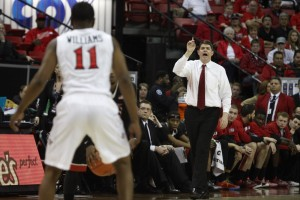UNLV head coach Dave Rice signals in a play in the first half of UNLV's MWC semifinal game against San Diego St.