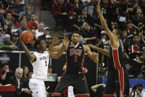 UNLV's Khem Birch and Bryce Dejean-Jones trap SDSU guard Xavier Thames in the second half of UNLV's MWC semifinal game against San Diego St.
