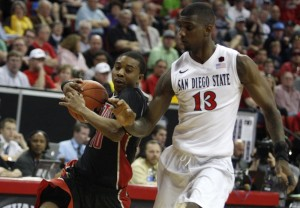 UNLV guard Daquan Cook drives into the lane against SDSU forward Winston Shepard in the second half of UNLV's MWC semifinal game against San Diego St.